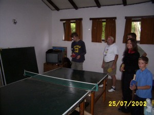 "Many of my students were often late back to class after our breaks.  (This ping pong table was right outside the door.)  Typically, they played a game called ""America"".  They formed a line and walked around the table.  They took turns hitting the ball.  I didn't play, but Randall is trying it out above."