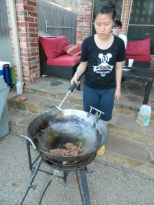 Jenny cooking the meat