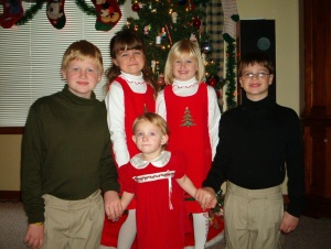 Gruenbaum Kids(and Sam) in Christmas garb